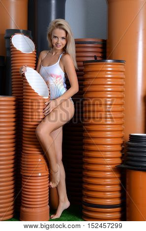 The sexual woman with PVC pipes