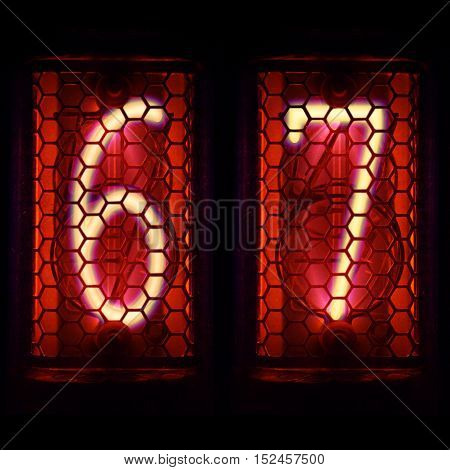 The  Nixie tube indicator of the numbers of retro style.  Digit 6, 7