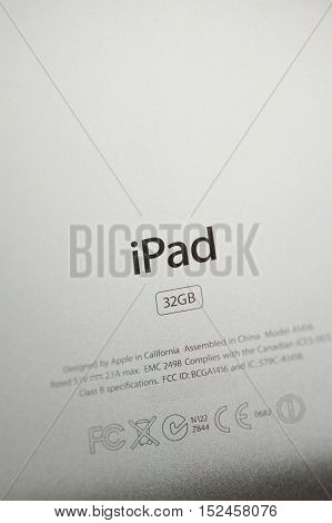 Rear view of iPad tablet with the engraved text and safety signs