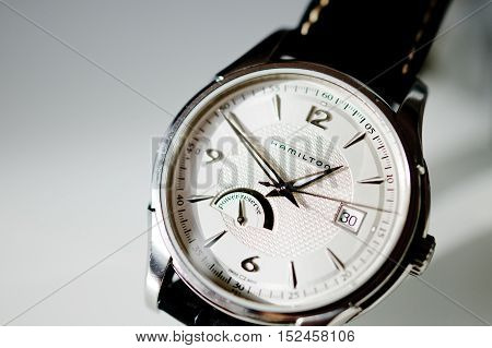 PARIS FRANCE - JAN 30 2014: Detail of Hamilton swiss made watch against white background. The Hamilton Watch Company is a brand of the Swatch Group a Swiss watch company based in Bienne Switzerland