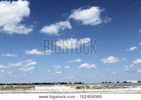 landscape of the Adriatic sea with blue sky and clouds