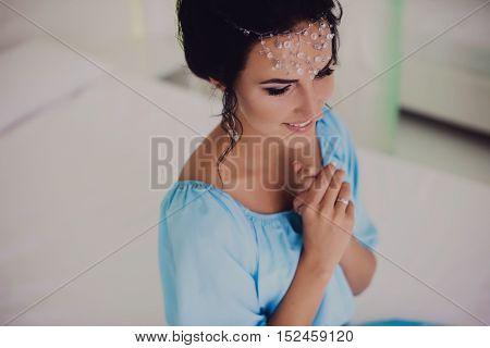 beautiful brunette bride in wedding dress studio
