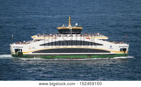 ISTANBUL TURKEY - JULY 30 2016: Sehir Hatlari ferry carry passengers between Asian and European sides of Istanbul. Sehir Hatlari was established in 1844 and now carry 150000 passengers a day.