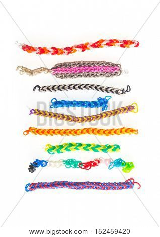 Assorted wrist bands made by kids with rubber bands. Making 'Loom bands' is a favorite hobby of children.