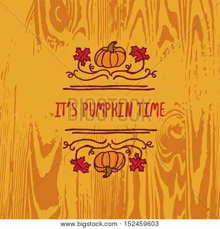 Hand-sketched typographic element with pumpkin, maple leaves and text on wooden background. Its pumpkin time