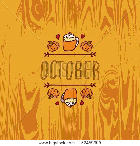 Hand-sketched typographic element with pumpkins, hearts, pumpkin spice latte and text on wooden background. October
