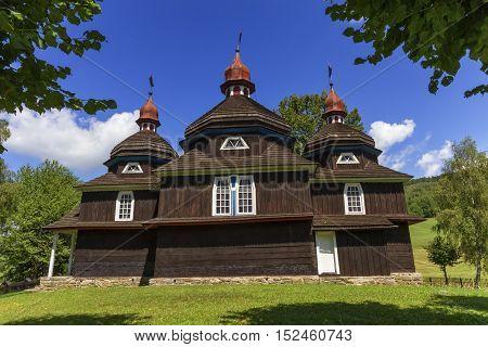 Beautiful greek catholic wooden church, UNESCO in Nizny Komarnik by day, Slovakia