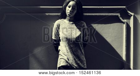 African Woman Standing Lean On Concrete Wall Casual Concept