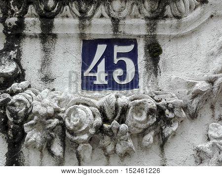 Number 45 in street sign in Pontedeume, Galicia, Spain