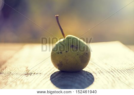 Fresh pears. On the wooden background. Free space for text . Toned image. Soft focus