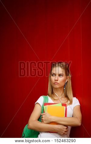 Serious girl with sunglasses on empty Brown background from afar