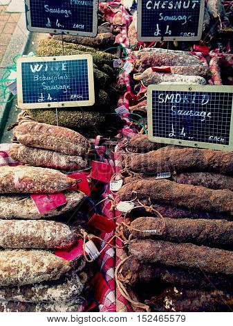 selection of french dried sausages on a market stall