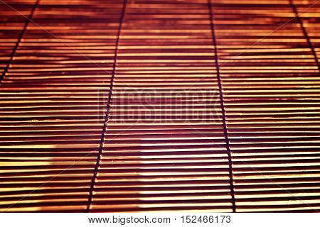 glare from bright sunlight through the wooden Roman Blinds