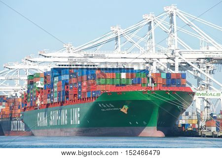 Oakland CA - September 28 2016: China Shipping Line Cargo Ship CSCL SOUTH CHINA SEA loading at the Port of Oakland the fifth busiest port in the United States.