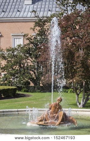 Aranjuez Spain - October 16 2016: Beautiful fountain near the Royal Palace of Aranjuez located in the Royal Site and town of Aranjuez UNESCO World Heritage site Madrid province Spain