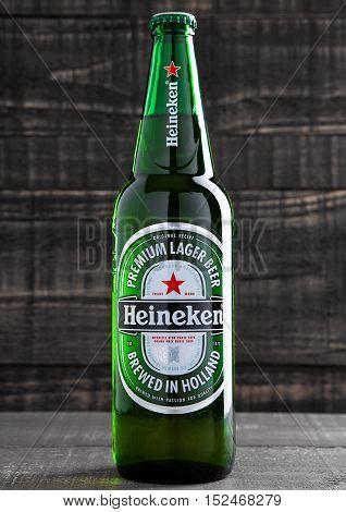 LONDONUK -OCTOBER 17 2016: Bottle of Heineken Lager Beer on grunge wooden background. Heineken is the flagship product of Heineken International