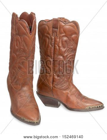 Women's fashion boots. Ladies vintage leather cowboy shoes. Isolated on a white background close-up.