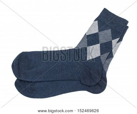 Warm woolen men socks with a pattern of rhombus diamonds. Isolated on a white background close-up top view.