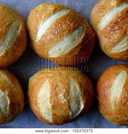 Golden Brown Pretzel Buns with Salt Flakes Sprinkled on Top