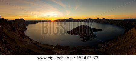 Crator lake sunrise panorama with orange sky