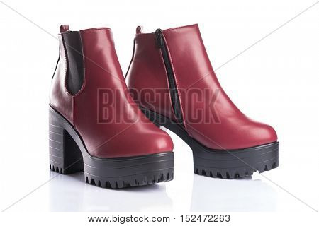 Pair of red autumn boots, isolated on white background