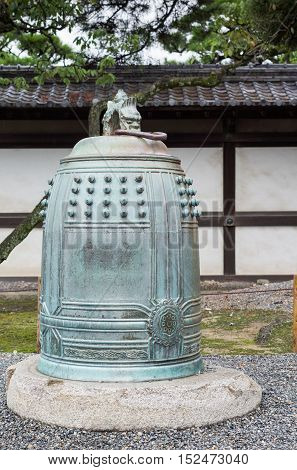Kyoto Japan - September 19 2016: One of two large bronze historic bells on display in the courtyard of Nijo Castle.