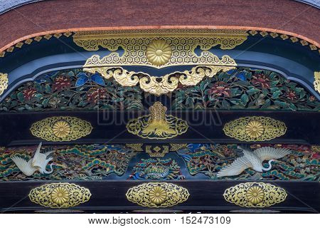 Kyoto Japan - September 19 2016: Closeup of wood carving at Kara-mon gate in Nijo Castle. Flowers butterflies cranes insects and golden decorations.