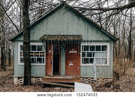 abandoned wooden building medical facility with open doors