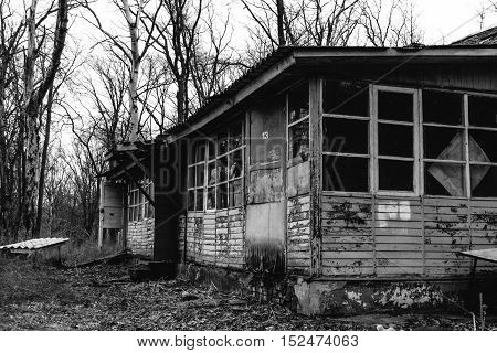 Abandoned house in a children's camp black and white photo