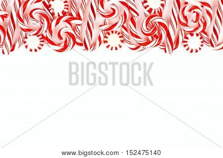 Christmas Candy Top Border With Peppermints And Candy Canes Over A White Background