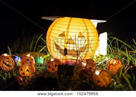 Halloween pumpkin head jack lantern in the garden select focus