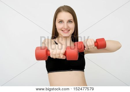 attractive fitness woman isolated on grey background