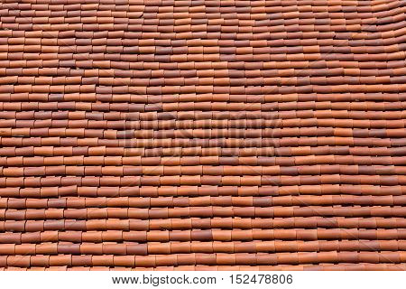 Many Curved Red Tile Roof Lines for background