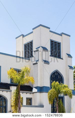 An old white stucco church in the tropics