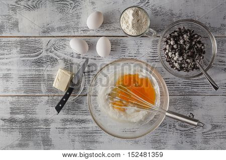 Baking In Rustic Kitchen Recipe Ingredients (eggs, Flour, Milk, Butter) On White Wooden Table From A