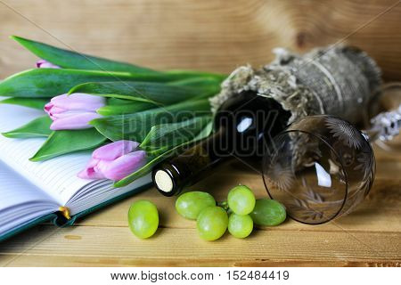 still life on the texture old wooden table bouquet of beautiful tulips an open book
