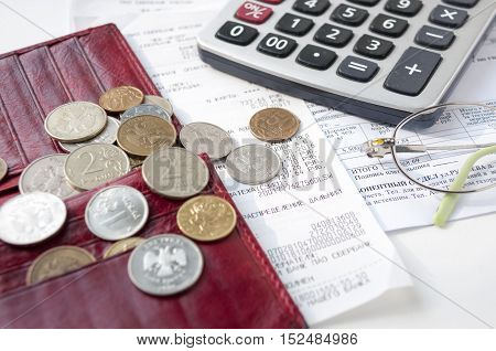 Still life with an empty wallet bills calculator and small rubles