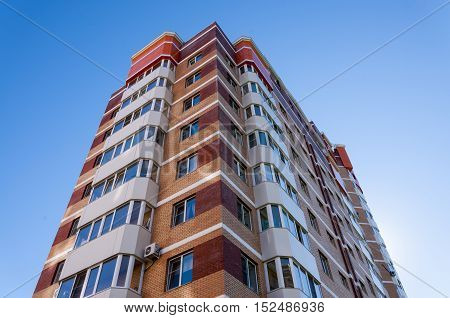 High-rise residential building on a background of blue sky