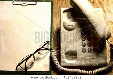 electronic home phone on a wooden table concept rescue call