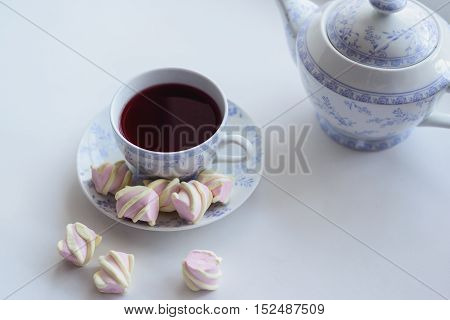 hot cup of red tea with marshmallow tenderness concept