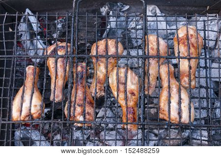 Chicken legs to roast over coals on the grill