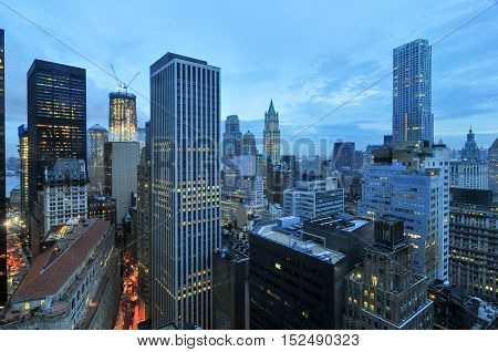 Aerial View of the skyscrapers of downtown Manhattan in New York City at dawn.