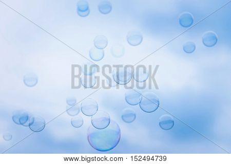 Rainbow Soap Bubbles on Blue Sky Background
