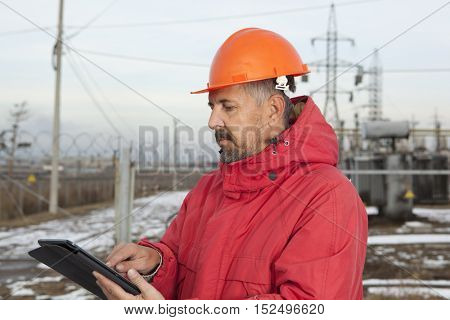 Engineer at Electrical Substation. Electrical power industry. Electric power distribution