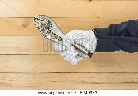 Hand In Glove Holding Adjustable Wrench