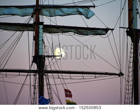 Sailing yacht tall ship illuminated by the light of a full moon great boating sailing background image