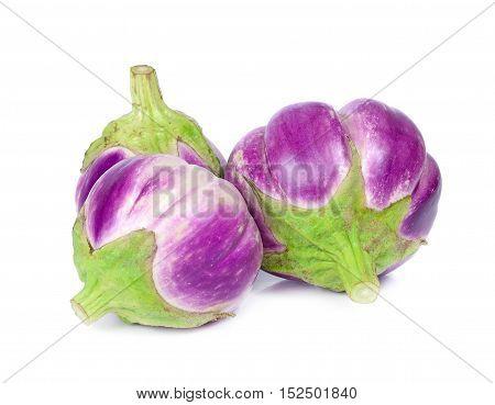 three purple eggplants isolated on whit background