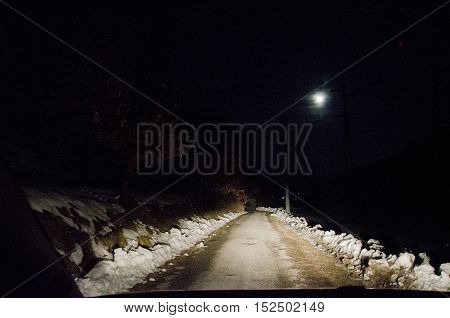 way through the snow at night in the moonlight covered in mist