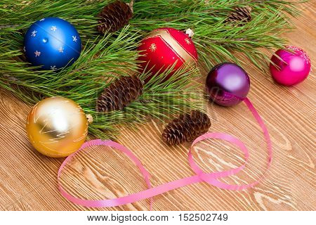 Pine tree branch with balls and fir cones