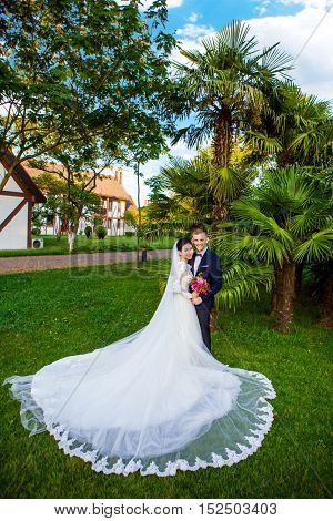 Portrait of wedding couple standing at lawn